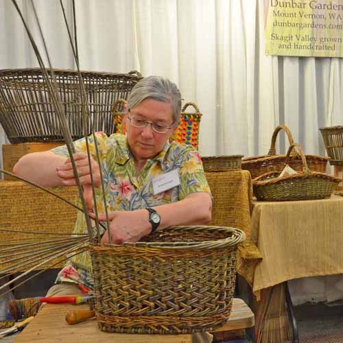 Katherine Lewis weaving a willow basket